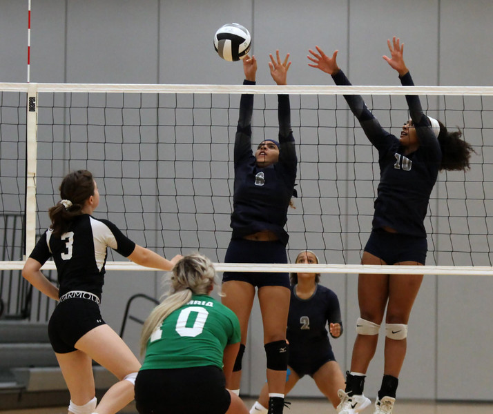 Randy Meyers - The Morning Journal<br /> Columbia's Danielle Roginsky spikes  the ball over Crystal Collazo (left) and Sydney Patterson of Lorain on  Saturday