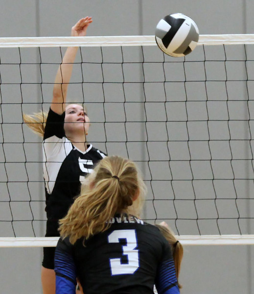 Randy Meyers - The Morning Journal<br /> Columbia's Laci Riley spikes the  ball for point during the first set against Midview on Saturday