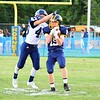 Brittany Chay - The News-Herald<br /> Kirtland receiver Palmer Capretta completes a catch in front of a Grand Valley defender.