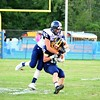 Brittany Chay - The News-Herald<br /> Kirtland receiver Palmer Capretta is wrapped up by a Grand Valley defender.