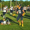 Brittany Chay - The News-Herald<br /> Kirtland tight end Owen Loncar leaves a Grand Valley defender in his wake.