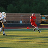 Coleen Moskowitz - The News-Herald<br /> Perry quarterback Kolston Brewster drops back to pass against Brush. Perry won, 8-3.