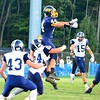 Brittany Chay - The News-Herald<br /> Kirtland receiver Jeremy Davis attempts to catch a pass as he's hit by a Grand Valley defender.