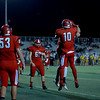 Coleen Moskowitz - The News-Herald<br /> Perry wide receiver Andy Foley celebrates his touchdown with teammates. Perry beat Brush, 8-3.