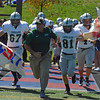 Paul DiCicco - The News-Herald<br /> Lake Catholic coach Scott O'Donnell leads the team onto the field before the Cougars' victory over Cleveland Central Catholic on Sept. 3 in Cleveland.