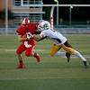Coleen Moskowitz - The News-Herald<br /> A Brush defender attempts to tackle a Perry ballcarrier. The Pirates beat the Arcs, 8-3.