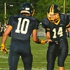 Brittany Chay - The News-Herald<br /> Kirtland tight end Owen Loncar (10) and quarterback Dylan Fulco (14) exchange a low five.
