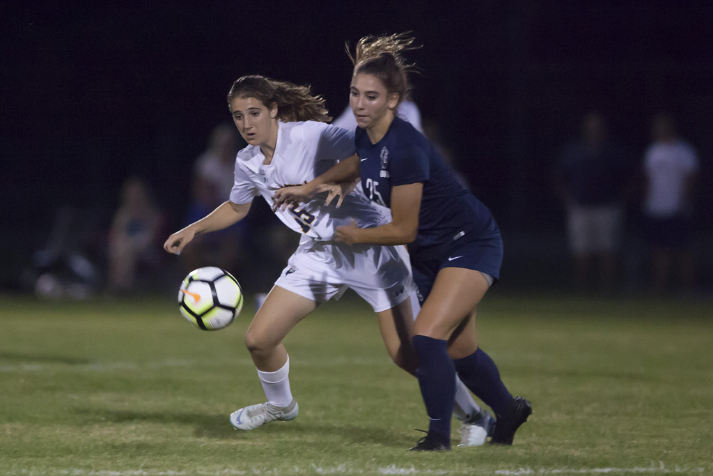 . Jen Forbus - The News-Herald North Ridgeville\'s Maggie Lardie and Olmsted Falls\' Madi Boka vie for the ball.