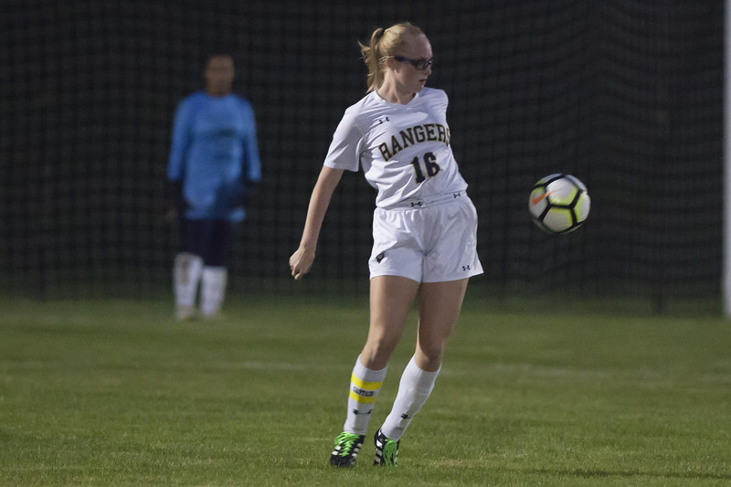Jen Forbus - The News-Herald<br /> Ranger Kayla Elswick uses a little hip action in North Ridgeville's contest against the Olmsted Falls Bulldogs.