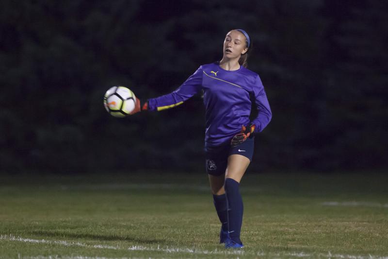 Jen Forbus - The News-Herald<br /> Olmsted Falls goalie Mackenzie Simon flings the ball back into play.