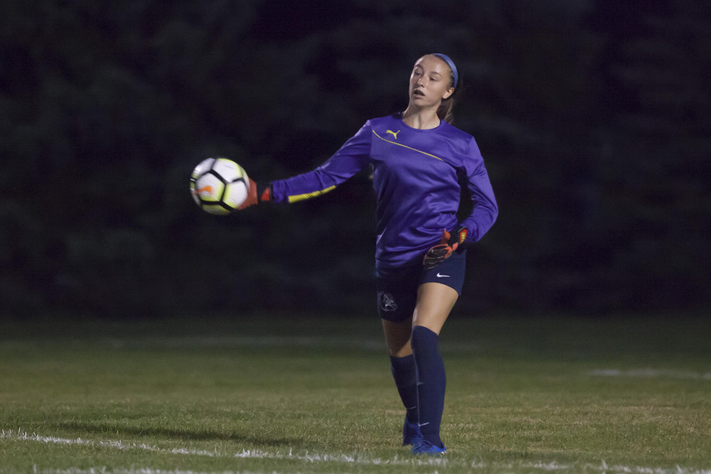 . Jen Forbus - The News-Herald Olmsted Falls goalie Mackenzie Simon flings the ball back into play.
