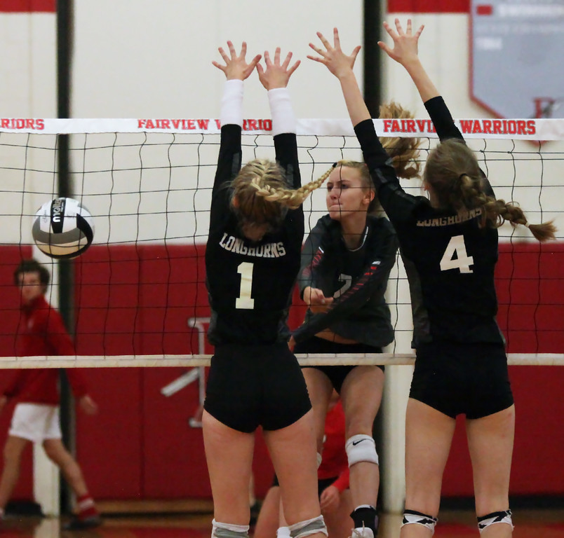 . Randy Meyers - The Morning Journal<br> Fairview\'s Jade Peace has her spike blocked by Sydney LaPointe and Clarice Turba of Lutheran West during the first set on Sept. 6.