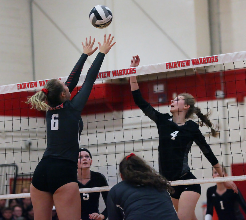 . Randy Meyers - The Morning Journal<br> Fairview\'s Madelyn Bochenek blocks the tip at the net by Clarice Turba of Lutheran West during the second set on Sept. 6.