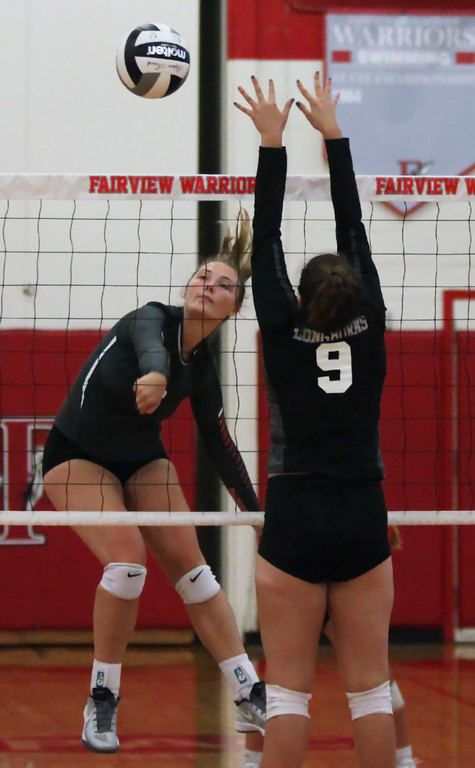 . Randy Meyers - The Morning Journal<br> Madelyn Bochenek of Fairview spikes the ball by Emma Bernardini of Lutheran West during the first set on Sept. 6.