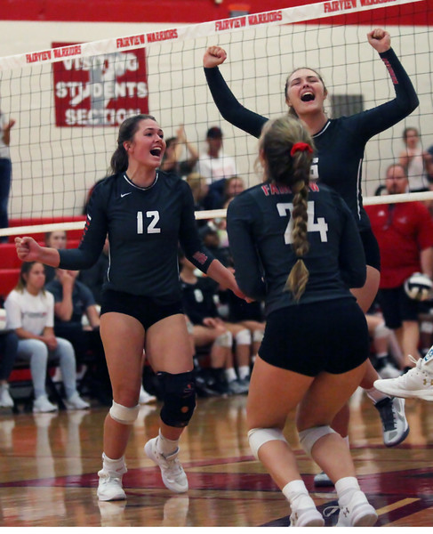 Randy Meyers - The Morning Journal<br> Fairview's Madelyn Bochenek, Abby Kuyper and Emma Szoradi celebrate after taking the second set against Lutheran West on Sept. 6.