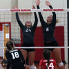 Randy Meyers - The Morning Journal<br> Emma Szoradi and Madelyn Bochenek of Fairview combine to block the tap by Lauren Kucharski of Lutheran West during the first set on Sept. 6.