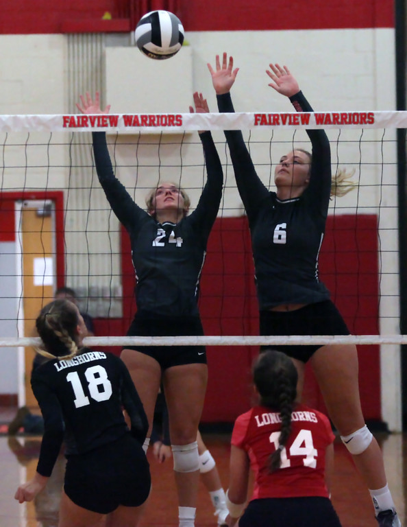 . Randy Meyers - The Morning Journal<br> Emma Szoradi and Madelyn Bochenek of Fairview combine to block the tap by Lauren Kucharski of Lutheran West during the first set on Sept. 6.