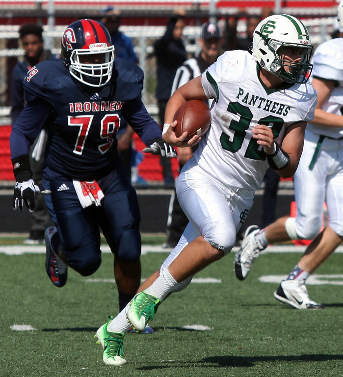 . Randy Meyers - The Morning Journal<br> Elyria Catholic\'s Leighton Banjoff  runs right and away from a Cleveland Central Catholic defender during the  fourth quarter on Saturday