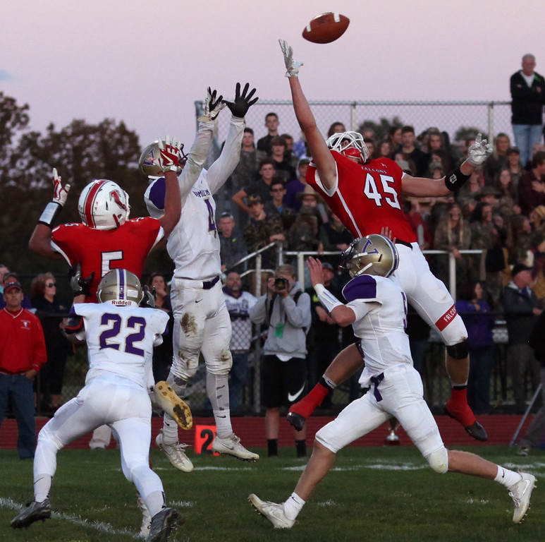 . Randy Meyers - The Morning Journal<br> Firelands\' Richard Maggard and Vermilion\'s Jonah Pfeil go up for a deep pass which was deflected and then intercepted by Vermilion on Sept. 8.