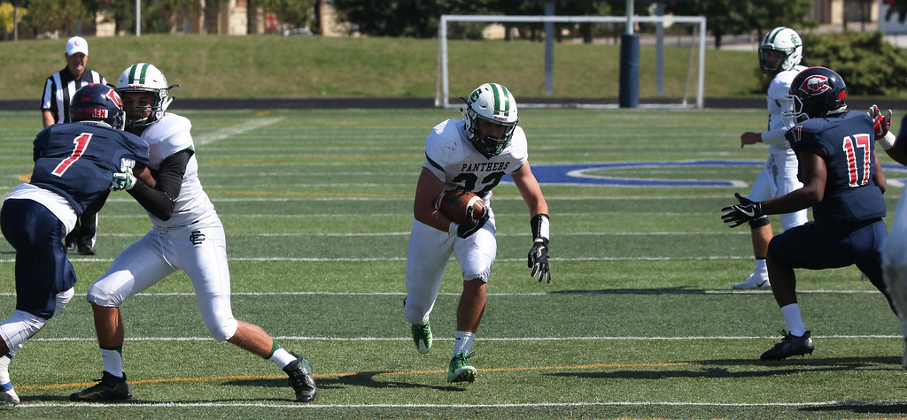 . Randy Meyers - The Morning Journal<br> Elyria Catholic running back Leighton Banjoff runs through a hug hole in the CCC defense during the second quarter on Saturday.