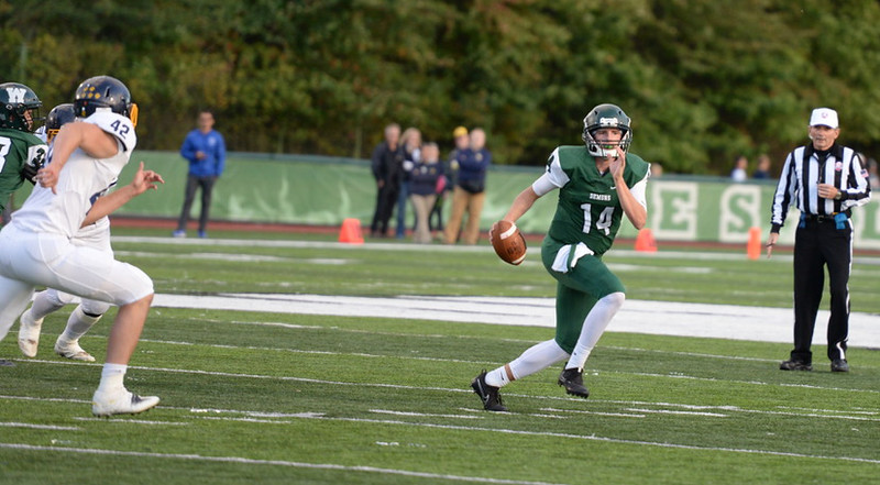 . Aimee Bielozer - The Morning Journal<br> Westlake quarterback Billy Blood looks for an open receiver as Olmsted Falls\' Jaden Mendeluk applies pressure on Sept. 8.