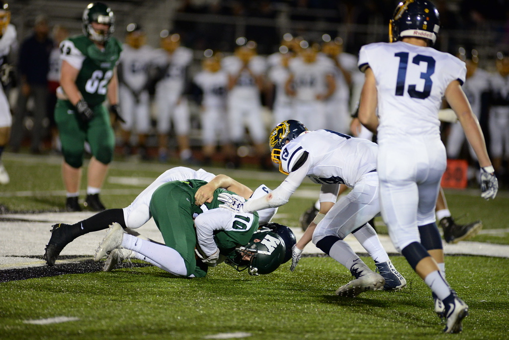 . Aimee Bielozer - The Morning Journal<br> Westlake\'s Jacob May is brought down by Olmsted Falls\' Nick Daily on Sept. 8.