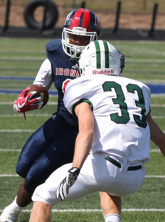 . Randy Meyers - The Morning Journal<br> CCC running back Anthony Billups  takes on Elyria Catholic defender Jace Drwal during the second quarter  on  Saturday.