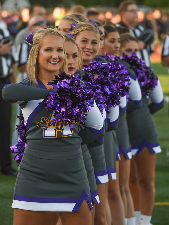 . Eric Bonzar�The Morning Journal<br> The Avon Eagles cheerleaders stand proud as the Avon and Avon Lake bands perform the Star Spangled Banner prior to the teams\' Southwestern Conference match-up, Sept. 8, 2017.