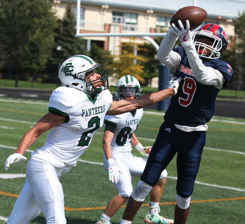 . Randy Meyers - The Morning Journal<br> Cleveland Central Catholic receiver Kody Bell catches a deep pass over Donovan Warfield of Elyria Catholic during the second quarter on Saturday.