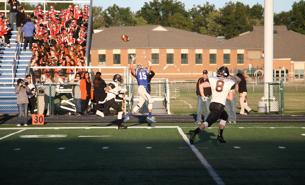 . Nicholas Pfeifer - The Morning Journal<br> Midview\'s Nick Crum goes up for a pass in the first quarter against North Olmsted on Sept. 8.