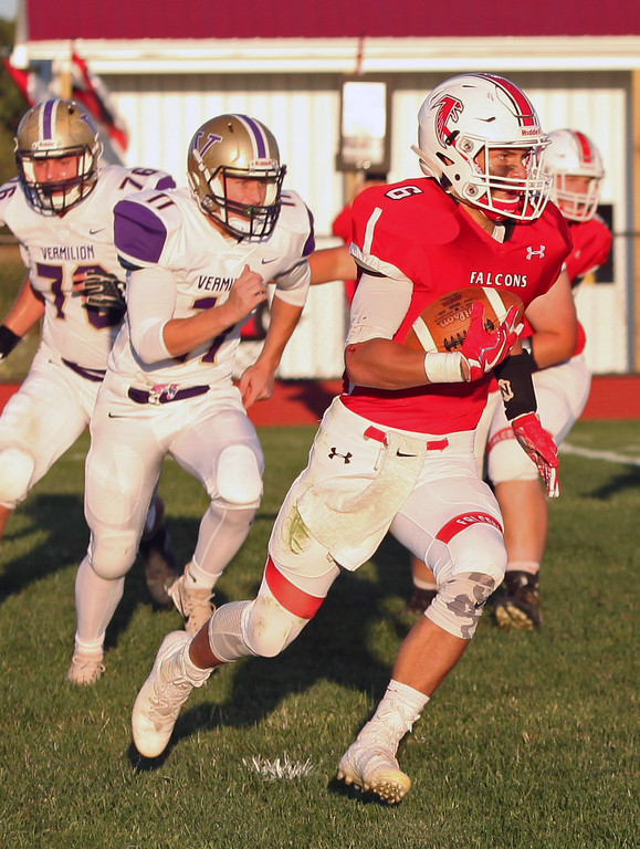 . Randy Meyers - The Morning Journal<br> Nick Denney of Firelands turns the corner on the Vermilion defense for a big gain during the first quarter on Sept. 8.