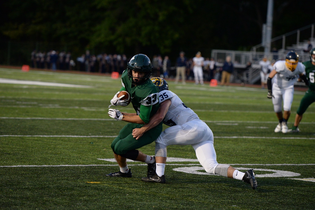 . Aimee Bielozer - The Morning Journal<br> Westlake\'s JJ Coleman tries to escape the tackle of Olmsted Falls\' Jack Spellacy on Sept. 8.