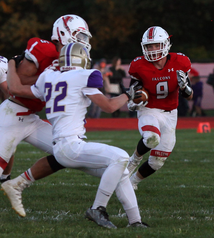 . Randy Meyers - The Morning Journal<br> Logan Strader of Firelands waits on a block against the Vermilion defense for a gain during the second quarter on Sept. 8.