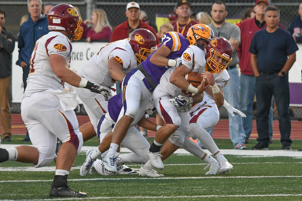 . Eric Bonzar�The Morning Journal<br> Avon Lake running back Konner Riggs (6) barrels ahead with Avon linebacker Alex Waters (37) on his back, Sept. 8, 2017.