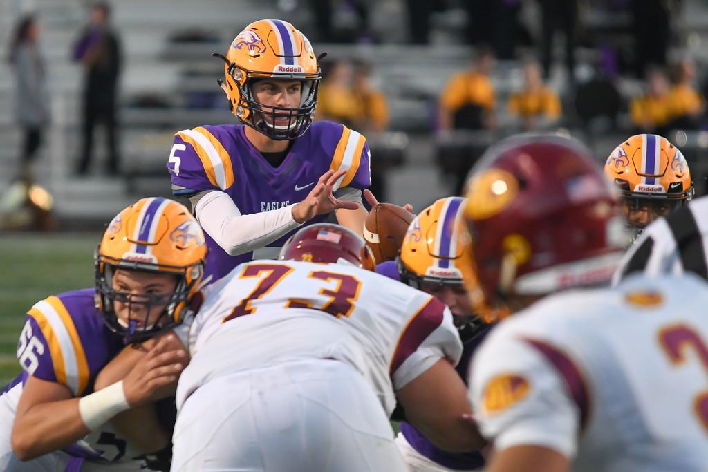 . Eric Bonzar�The Morning Journal<br> Avon quarterback Ryan Maloy (5) takes a snap under center, Sept. 8, 2017.