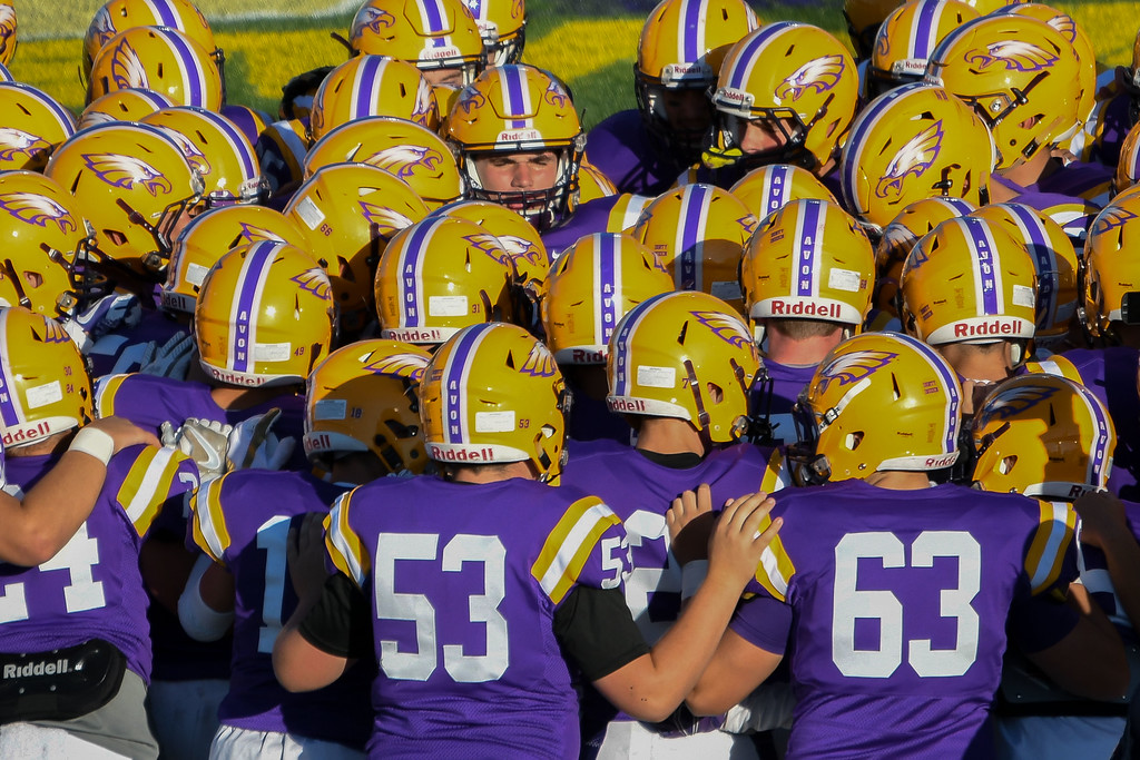 . Eric Bonzar�The Morning Journal<br> The Avon Eagles huddle up before kick-off of their Southwestern Conference home game against the Avon Lake Shoremen, Sept. 8, 2017.