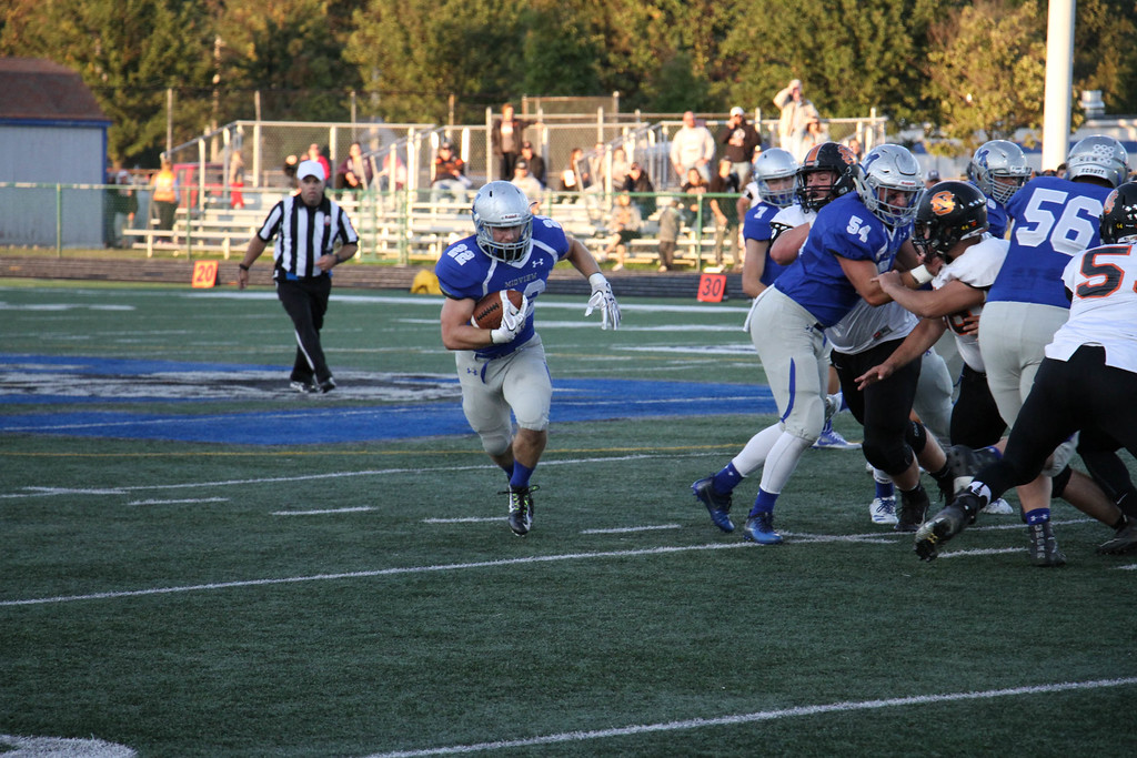 . Nicholas Pfeifer - The Morning Journal<br> Midview\'s Connor Wolfe follows his blockers to the outside for a big gain against North Olmsted on Sept. 8.