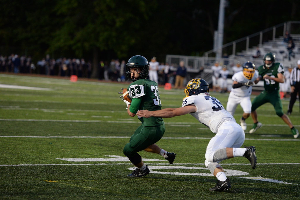 . Aimee Bielozer - The Morning Journal<br> Westlake\'s JJ Coleman tries to evade a tackle by Olmsted Falls\' Jack Spellacy on Sept. 8.
