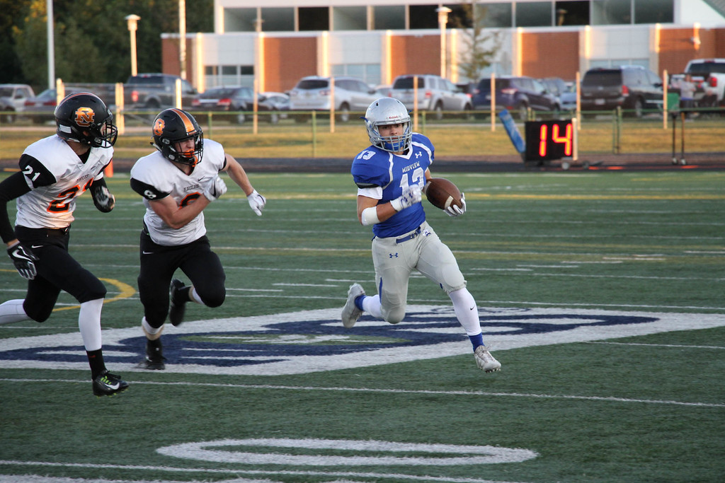 . Nicholas Pfeifer - The Morning Journal<br> Midview\'s Noah Markus returns a North Olmsted punt for a big gain on Sept. 8.