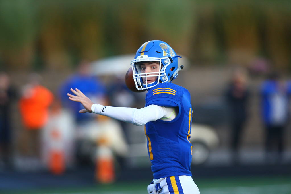 . David Turben - The News-Herald NDCL quarterback Nick Gattozzi (11) looks to throw a pass.