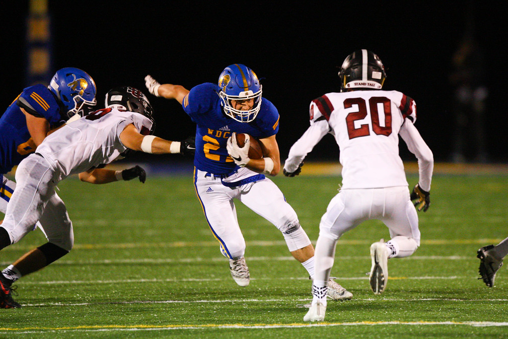 . David Turben - The News-Herald NDCL running back Kyle Medves (21) runs up the middle.