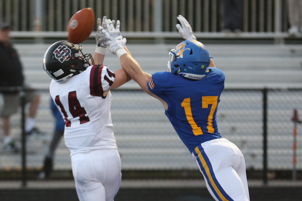 . David Turben - The News-Herald University receiver Nic Pujolas (14) can\'t pull in this pass in the end zone with the tight defensive coverage by NDCL\'s Steve Daily (17).