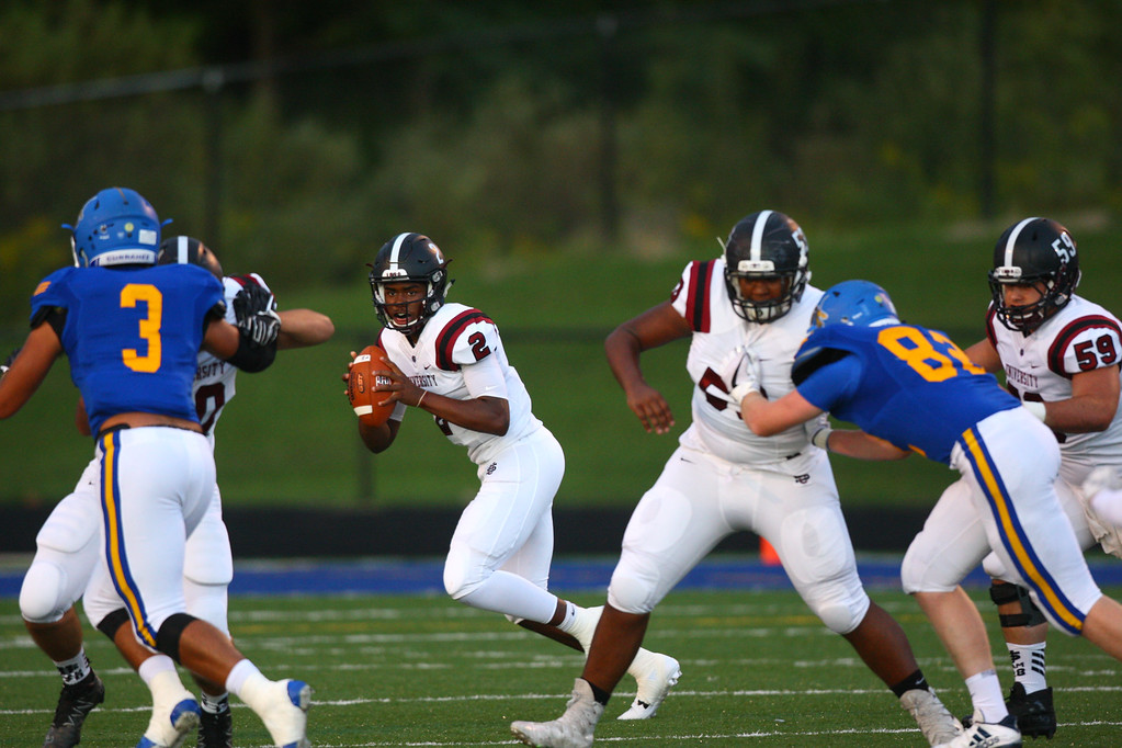 . David Turben - The News-Herald University quarterback Jayden Cunningham (2) rolls out to pass.