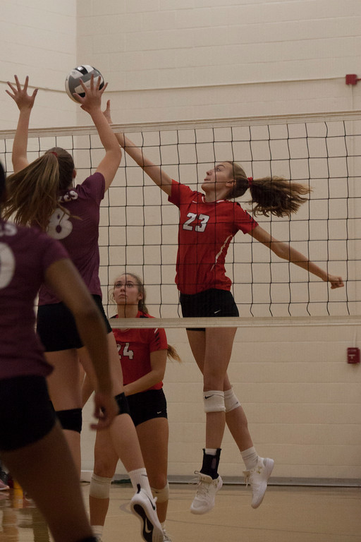 . Jen Forbus - The Morning Journal<br> Fairview\'s Jade Peace tips the ball over the net as Wellington\'s Alexis Lehmkuhl tries to block her shot on Sept. 8.