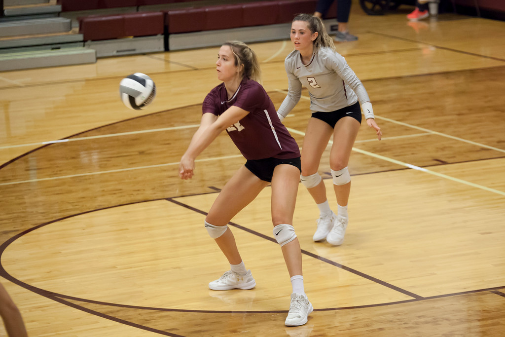 . Jen Forbus - The Morning Journal<br> Rocky River\'s Olivia Young returns a serve from North Olmsted on Sept. 8.