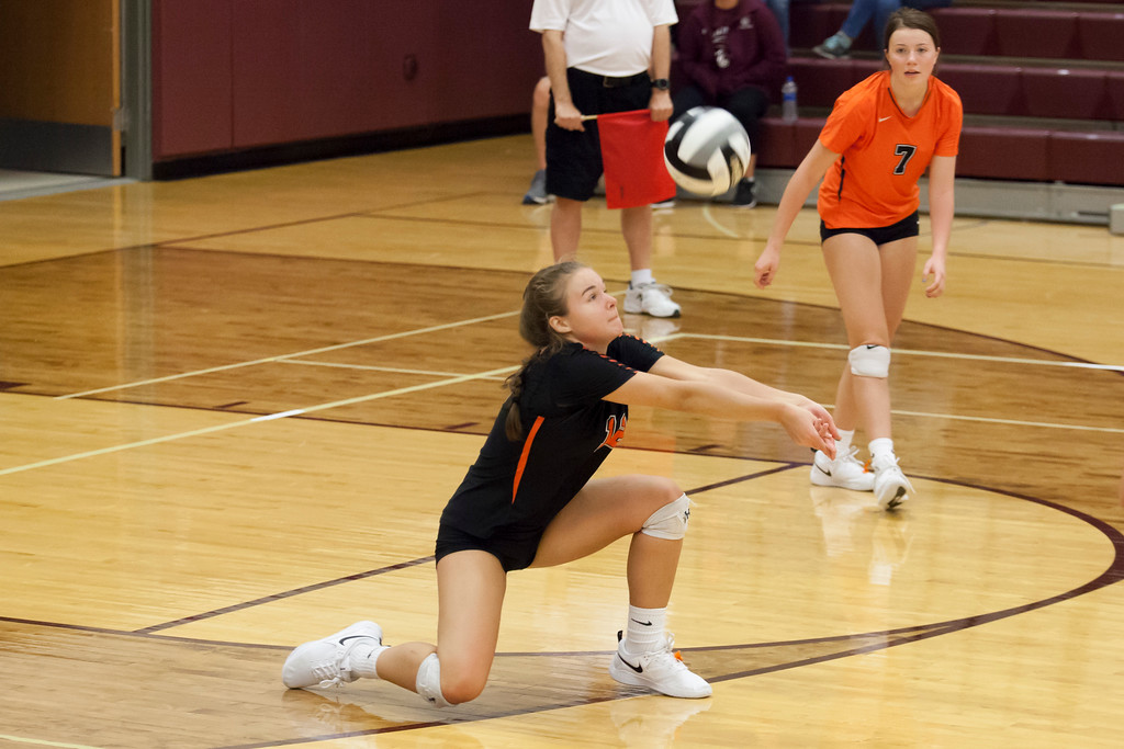 . Jen Forbus - The Morning Journal<br> North Olmsted\'s Jessica Yelsik returns a serve in the Eagles\' match against the Trinity Trojans on Sept. 8.