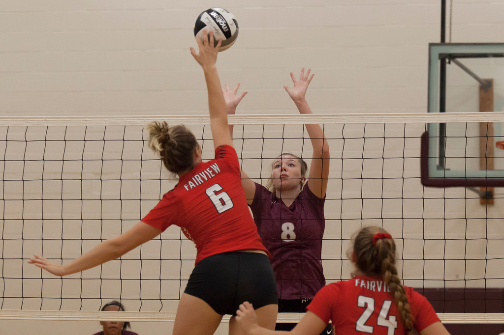 . Jen Forbus - The Morning Journal<br> Wellington\'s Alexis Lehmkuhl keeps her eyes on Fairview\'s Madelyn Bochenek attempting a spike on Sept. 8.