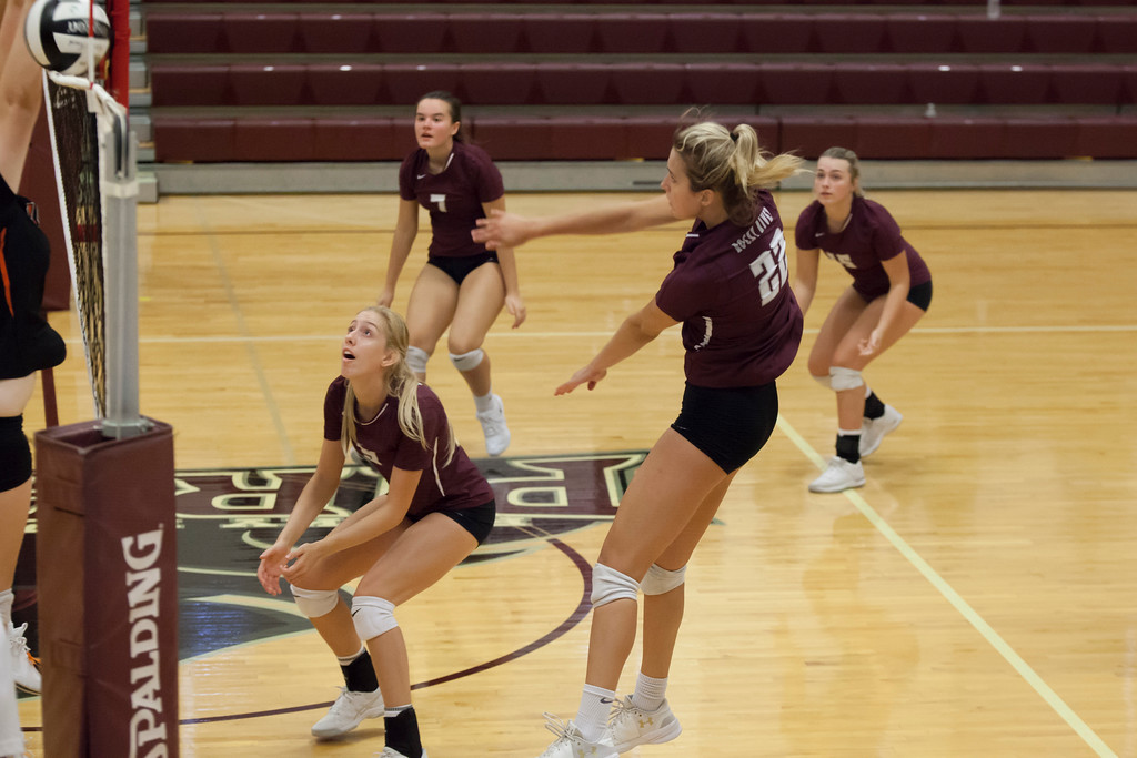 . Jen Forbus - The Morning Journal<br> Rocky River\'s Olivia Young sends a shot skimming over the top of the net to the North Olmsted Eagles on Sept. 8.