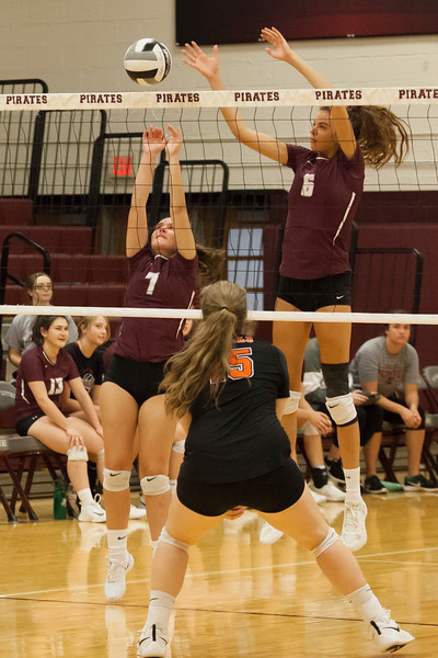 Jen Forbus - The Morning Journal<br> Rocky River's Ava Rauser (6) and Molly Sheridan team up for a block in their match against the North Olmsted Eagles on Sept. 8.