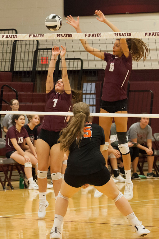 . Jen Forbus - The Morning Journal<br> Rocky River\'s Ava Rauser (6) and Molly Sheridan team up for a block in their match against the North Olmsted Eagles on Sept. 8.